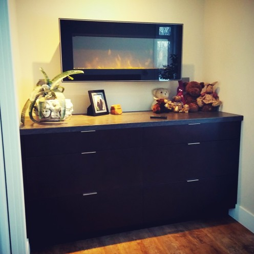built in dresser with fireplace design by deborah nicholson lighitng and interiors