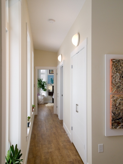 High wall lights solution for sloped ceiling designed by deborah nicholson lighting and interiors