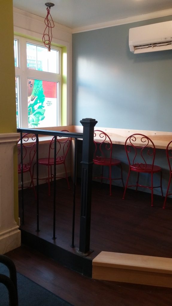 These pop-of-red chairs will go outside once new upholstered chairs arrive for the new eat at counter.